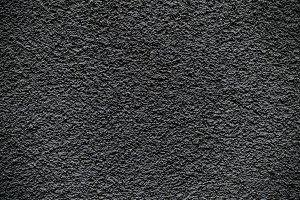 Black revetment wall macro texture