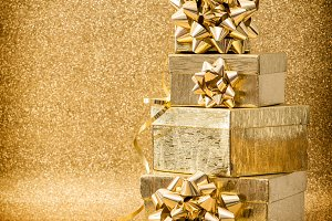 Gifts with golden ribbon bow