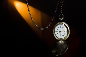 Antique silver pocket watch on a cha