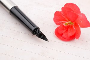 Notebook, pen and flower