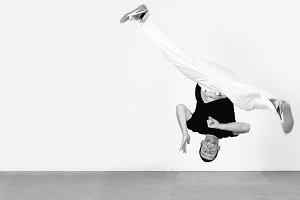 Man jumping, dancing capoeira