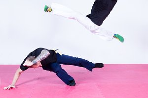 Two men exercising capoeira