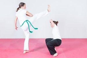 Two women dancing capoeira.jpg
