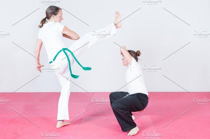 Two women dancing capoeira.jpg - Sports