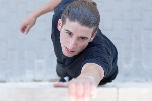 Young athlete climbing on wall