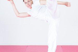 Young woman dancing capoeira