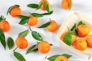 Tangerines on white tablecloth