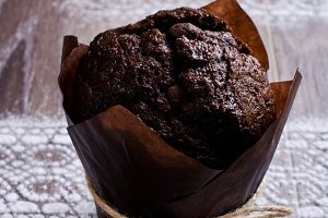 Chocolate muffin in baking paper