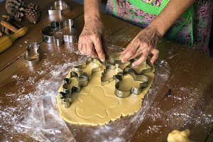woman making Christmas cookies