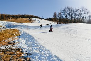 Ski Lesson - Skiers on Downhill