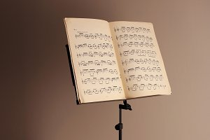 Music stand on brown background