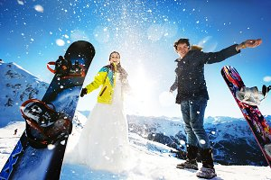 Newlyweds snowboarding