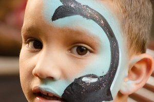 Child with painted face.