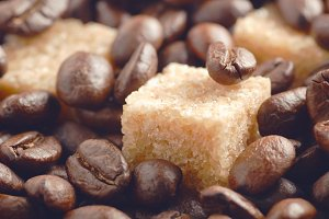 Сane sugar covered by coffee beans