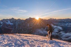 Man and dog enjoying the sunrise