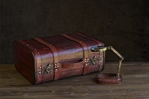 suitcase with magnifying glass