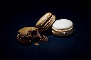 macaroons on a black background