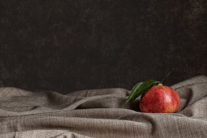 Juicy pomegranate on fabric