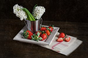 Strawberries with hyacinths