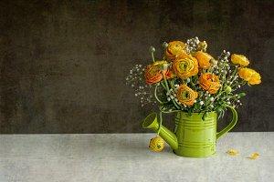 rustic still life flowers in waterin