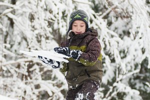 boy playing in the snow