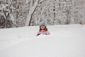 girl outdoors in a snowstorm