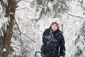 Teen boy shoveling snow