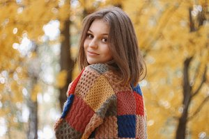 Beautiful autumn smiley woman