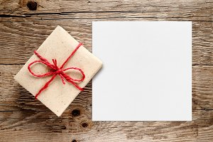 Gift box and white blank paper