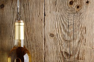 Wine bottle on old wood