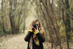 Woman taking photos at forest