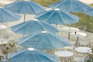 Blue umbrellas and a cola