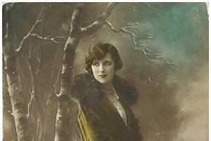 young woman in green coat