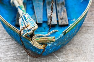 Blue wooden shabby fishing boat
