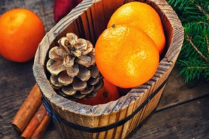 Wooden bucket with tangerines