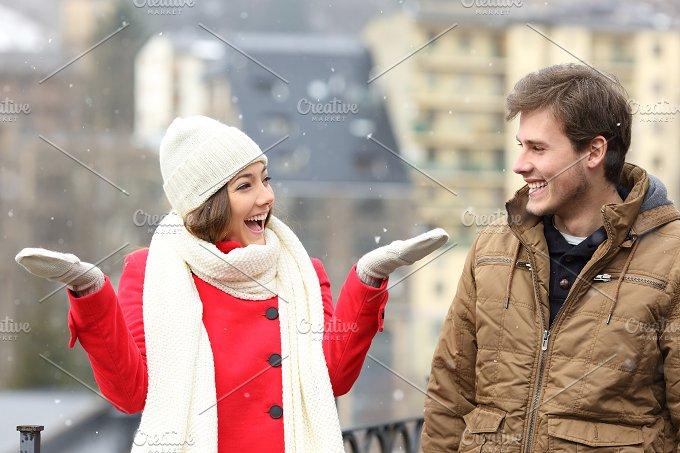 Couple enjoying snow in a snowy day.jpg - Holidays