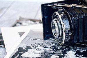 photo camera on pile of old photos