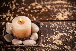 Candle and stones