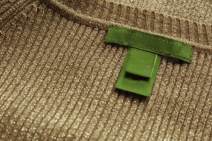 Green label,sewn on delicate sweater