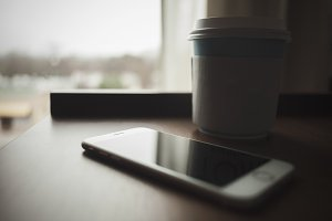 To-Go Coffee Next to an iPhone