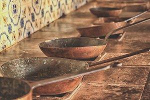 Copper pans in antique kitchen