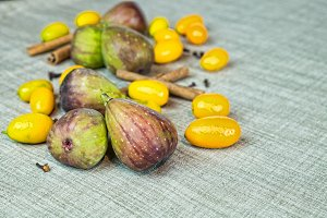 Figs and kumquat fruits with spices