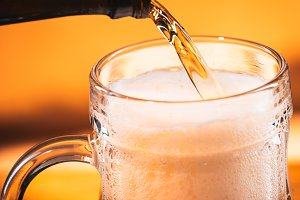 bright  beer is  poured into a glass