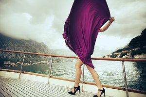 Woman in a dress near the ocean
