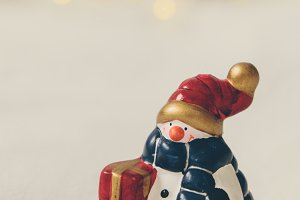 Snowman on white scene