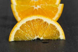 Sliced Orange Fruit on Stone