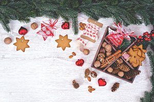 Christmas decoration cookies hanging over the white wooden background