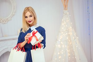 Portrait of a beautiful woman holding christmas gift box