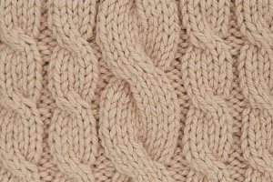 handmade beige knitting wool texture background