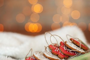 Gingerbread cookies in box on a white fur background